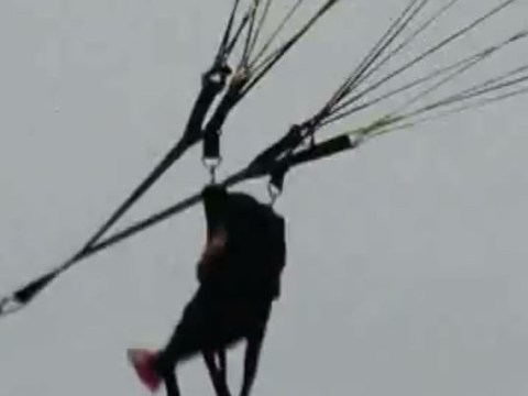Are these the most irresponsible adults? Shocking moment a screaming baby is forced to paraglide – alone