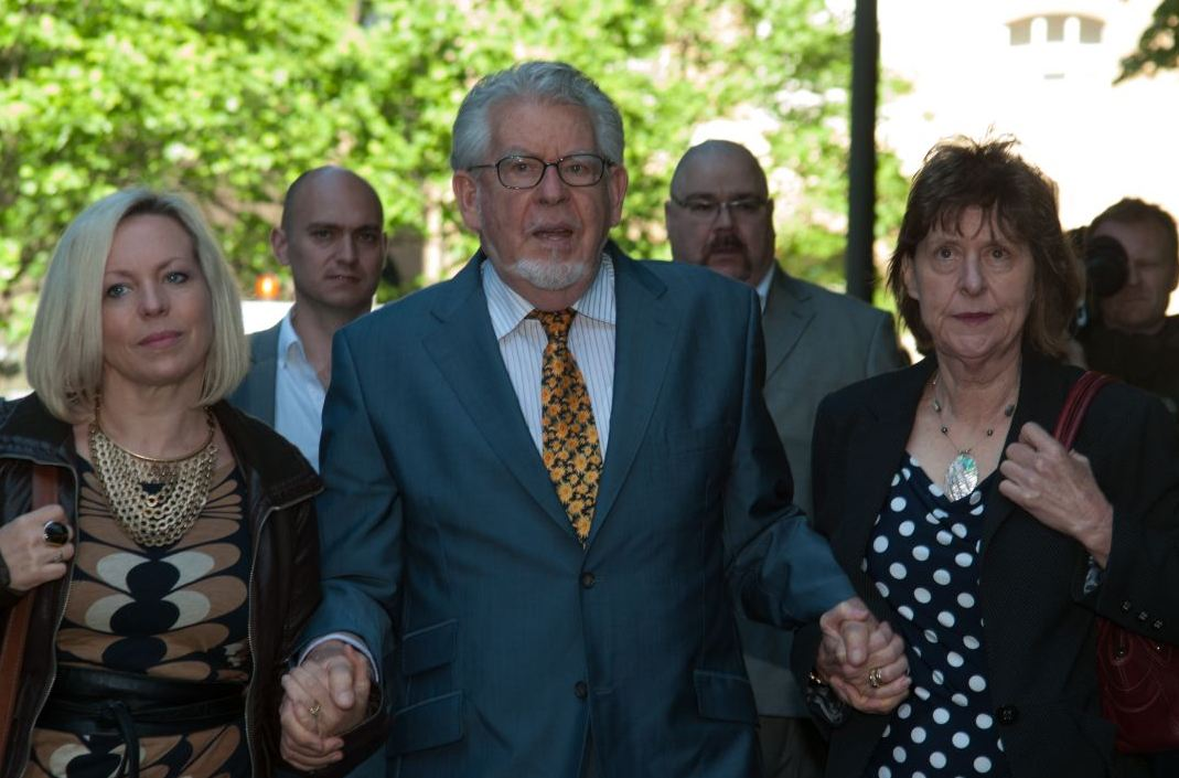 Rolf Harris arrives at Southwark Crown Court with daughter Bindi (left) (Picture: PA)
