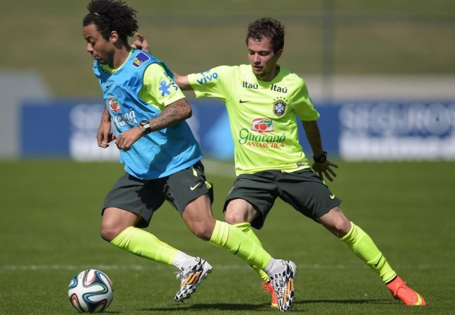Bernard, right, and Brazil team-mate Marcelo train with the squad last week (Picture: Getty Images)