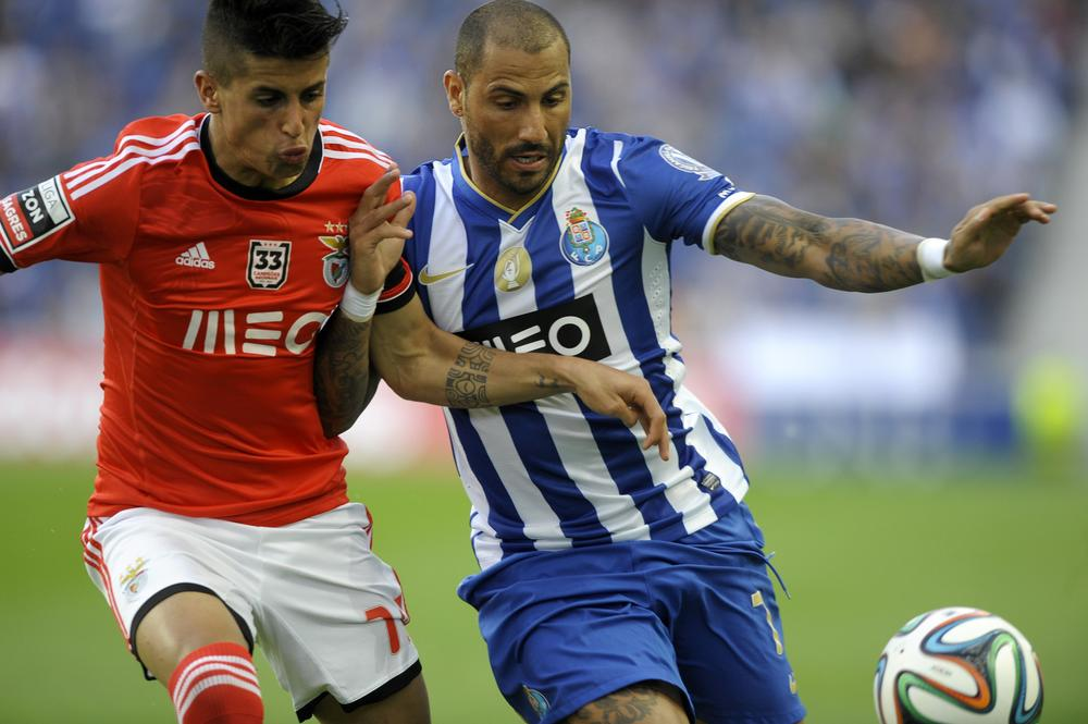 Benfica's defender Joao Cancelo (L) vies with Porto's forward Ricardo Quaresma during the Portuguese League football match FC Porto vs SL Benfica at the Dragao stadium in Porto on May 10, 2014. AFP PHOTO / MIGUEL RIOPA MIGUEL RIOPA/AFP/Getty Images