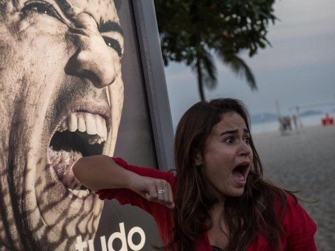 World Cup fans queue up to get 'bitten' by Luis Suarez as #Suarezing becomes a thing