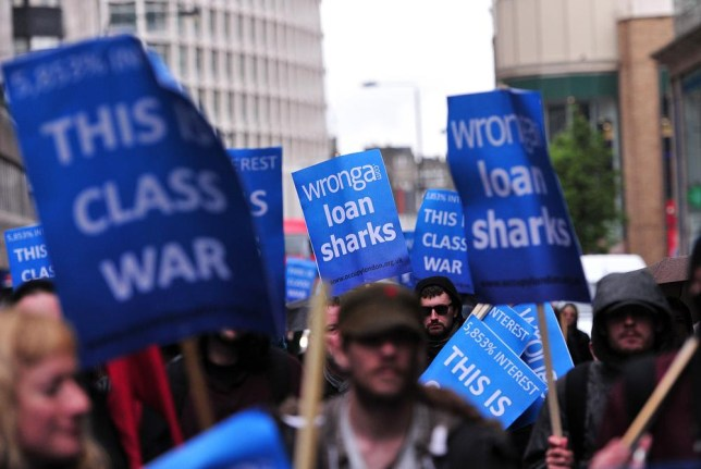 Protesters demonstrate against British payday loan company 'Wonga' in central London, on May 1, 2014. AFP PHOTO/CARL COURT CARL COURT/AFP/Getty Images
