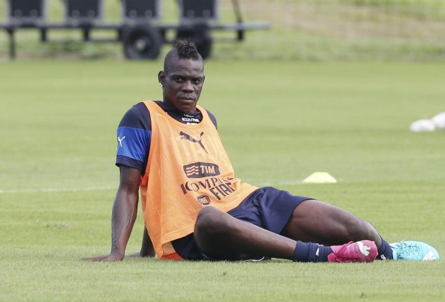 Italy's Mario Balotelli stretches during his team's training session for the World Cup in Mangaratiba, Brazil, Wednesday, June 11, 2014. The international soccer tournament starts on Thursday. (AP Photo/Antonio Calanni) AP Photo/Antonio Calanni