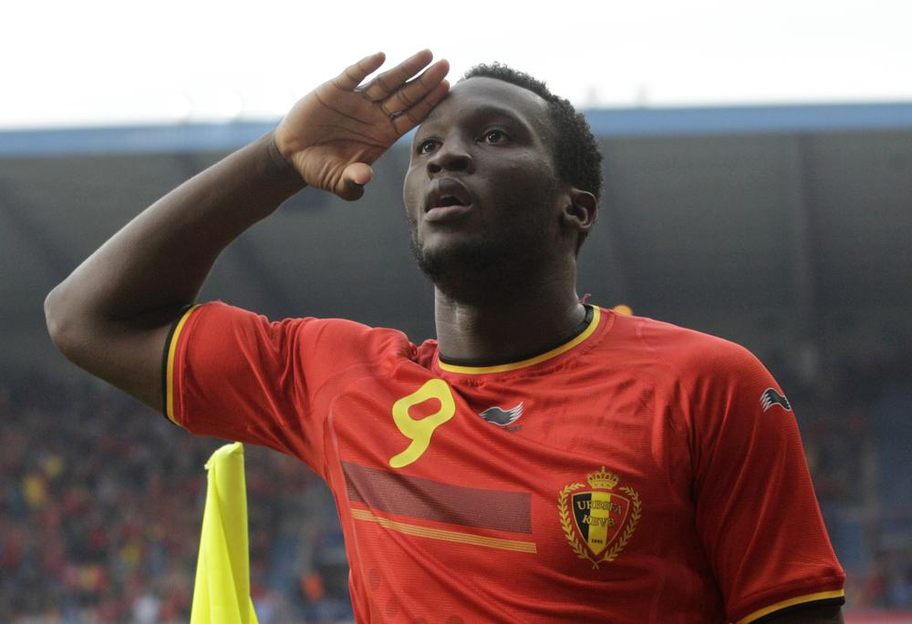 Belgium's Romelu Lukaku salutes after he scored against Luxembourg, during a friendly soccer match at the Cristal Arena stadium in Genk, eastern Belgium, Tuesday, May 26, 2014. Belgium will play against South Korea, Russia and Algeria in Group H of the World Cup 2014 in Brazil. (AP Photo/Yves Logghe) AP Photo/Yves Logghe
