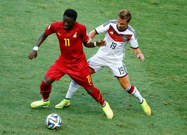 Ghana's Muntari is challenged for the ball by Germany's Goetze during their 2014 World Cup Group G soccer match at the Castelao arena in Fortaleza
