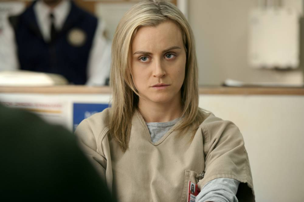 This image released by Netflix shows Taylor Schilling in a scene from ìOrange is the New Black.î The second season of the prison series will be available on Friday, June 6, on Netflix. (AP Photo/Netflix, JoJo Whilden)
