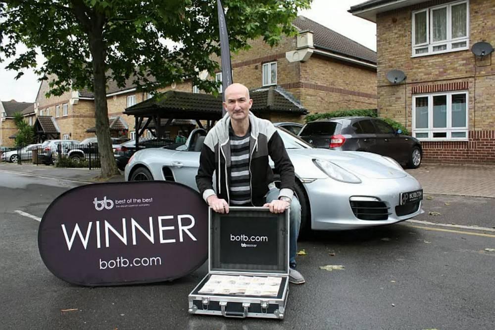 Jobless benefits man wins £53k Porsche on spot-the-ball game