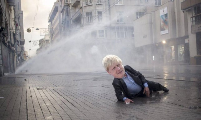 Mandatory Credit: Photo by GOKHAN POLAT/LEJOURNAL/SIPA/REX (3753168i)nA man lies on the ground after being hit by a water cannon during the protests in central Istanbul's Istiklal Avenue.nDemonstration following mine disaster, Istanbul, Turkey - 14 May 2014nTurkish police fired tear gas and water cannon on to disperse the crowd of several thousand demonstrators who gathered in central Istanbul district of Beyoglu to protest over a mine disaster which killed at least 245 people.n