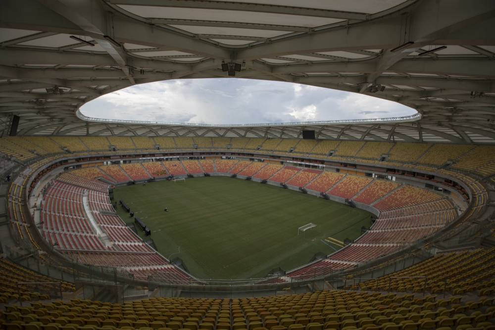This May 20, 2014 photo shows the inside of of the Arena da Amazonia soccer stadium in Manaus, Brazil. It was supposed to have been finished in 2013, but even just three weeks before the start of World Cup play, crews were scrambling to finish wiring and other crucial work. The new 44,500-seat stadium, with its wicker basket-styled frame, would be a worthy field for any top-division soccer team _ if only Manaus actually had one to use it. (AP Photo/Felipe Dana)