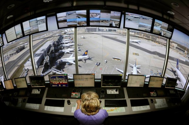 A control tower operator supervises starting and landing planes from a new control tower at Frankfurt international airport on April 23, 2010 in Frankfurt am Main. Two new towers have been built due to the growing traffic at this airport. Some 80 operators control the ground traffic of the planes in Frankfurt.     AFP PHOTO DDP / THOMAS LOHNES     GERMANY OUT (Photo credit should read THOMAS LOHNES/AFP/Getty Images)