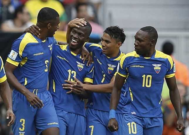 Ecuador's forward Enner Valencia (2nd L) celebrates scoring with his teammates during a Group E football match between Switzerland and Ecuador at the Mane Garrincha National Stadium in Brasilia during the 2014 FIFA World Cup on June 15, 2014. AFP PHOTO / ADRIAN DENNISADRIAN DENNIS/AFP/Getty Images