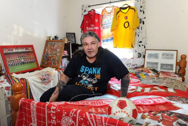 John Eastman who has an Arsenal tattoo which he is having removed in protest after the club sold Fabregas to Chelsea. See SWNS story SWGUNNER; A diehard Arsenal fan has had a tattoo of the teamís crest covered up on his chest and binned decadesí worth of memorabilia in outrage at its manager. John Eastman, who lives on West Hoe, went down to a tattoo parlour yesterday to have his tattoo of the clubís crest covered with another design after ArsËne Wenger turned down a first option to buy F·bregas. Mr Eastman, who has supported the club since he was 10, decided he no longer wanted the tattoo or the hundreds of souvenirs he had collected over the years after the player was sold to Chelsea yesterday. ìWenger wonít put his hand in his pocket to buy players, heís too tight. Heís broken my heart,î the 55-year-old said.