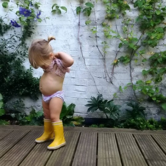 Courtney Adamo's picture of her daughter Marlow which fell foul of Instagram's community guidelines. See SWNS story SWNIPPLE; A mum had her Instagram account taken down after she fell foul of their stringent ëno nipplesí rule after she posted a topless picture of her daughter ñ who is just 19 MONTHS OLD. Courtney Adamo, 33, had her account shut down on Thursday for ìviolating the community guidelinesî ñ and had several of her pictures removed for being ëinappropriateí ñ despite just posting innocent pictures of her children. The blogger, who writes for online boutique Babyccino Kids, had posted a photo the night before of her 19-month-old daughter Marlow wearing yellow rain-boots and her ìbig girl undiesî. Mum-of-four Courtney, from Hampstead, north London, said: ìIt is so ridiculous. Iíve been in touch with a few other mums who told me the rules state any children of walking age canít be shirtless in pictures on the site.