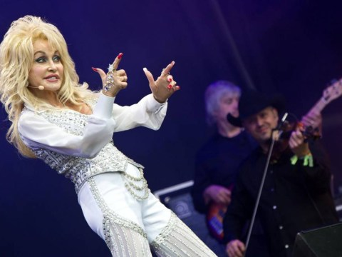 Flawless Dolly Parton plays the Benny Hill theme on a rhinestone saxophone at Glastonbury 2014