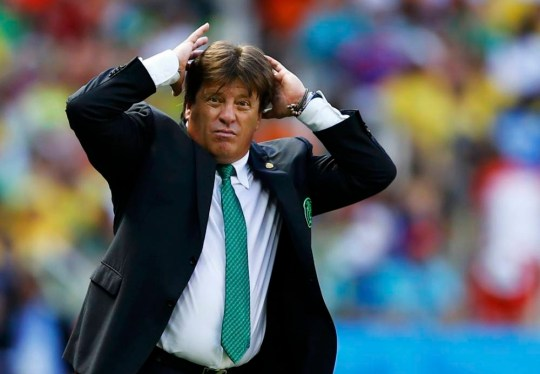 Mexico's coach Miguel Herrera reacts during the last few minutes of their 2014 World Cup round of 16 game against the Netherlands at the Castelao arena in Fortaleza June 29, 2014. REUTERS/Marcelo Del Pozo (BRAZIL  - Tags: SOCCER SPORT WORLD CUP TPX IMAGES OF THE DAY)