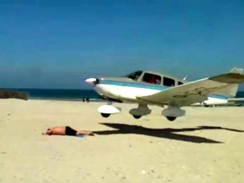 Pilot says sorry after narrowly avoiding sunbather in beach crash landing