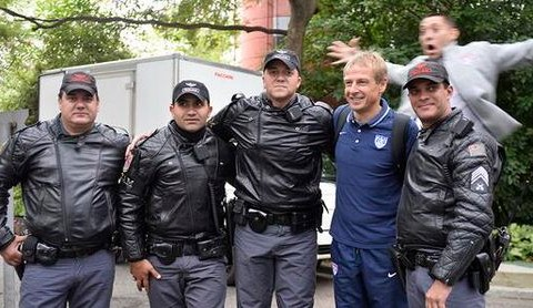 Clint Dempsey pulls off hilarious photobomb behind USA coach Jurgen Klinsmann and Brazilian police