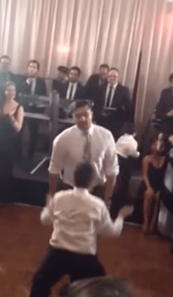 Forget the first dance: father and son rock the dance off at wedding