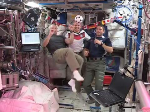 Astronauts play zero gravity football on the International Space Station