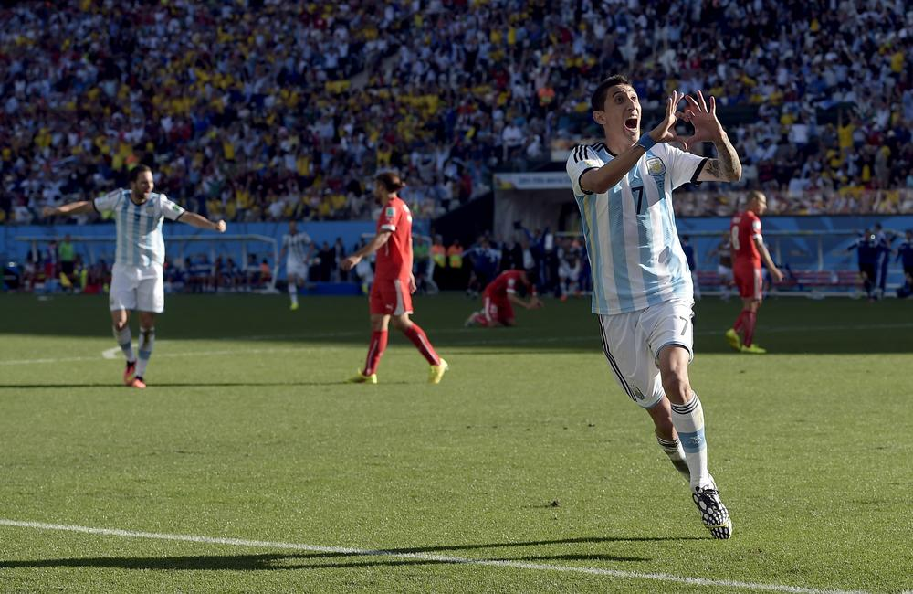 Lionel Messi and Angel di María combine late on to banish Argentina's fears