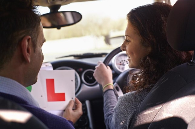 Driving instructor showing Learner Plate to learner driver Dark Horse/Dark Horse
