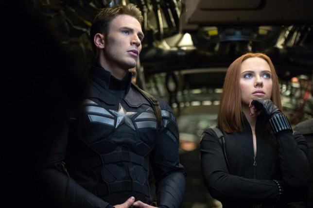 """This image released by Marvel shows Chris Evans, left, and Scarlett Johansson in a scene from """"Captain America: The Winter Soldier."""" (AP Photo/Marvel-Disney) AP Photo/Marvel-Disney"""
