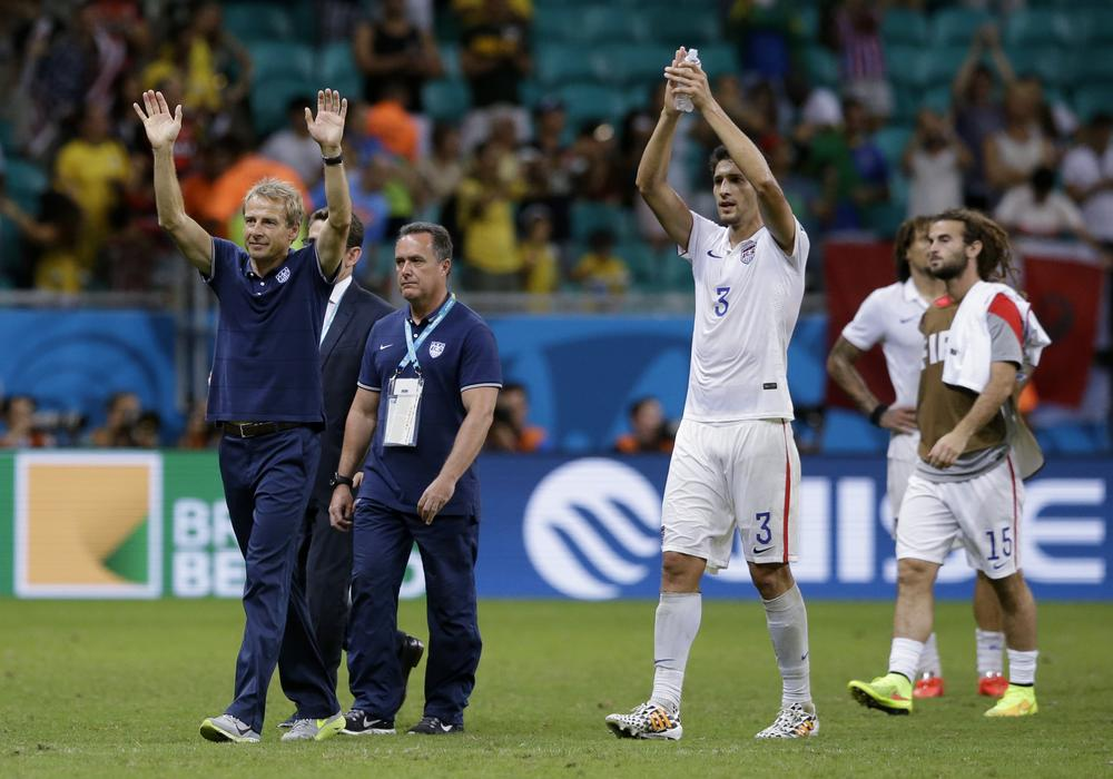 Tim Howard heroics can't save USA against Belgium, but team return to America as winners