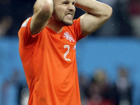 Cruel end for concrete Ron Vlaar and Netherlands at World Cup
