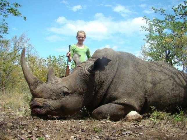 """A teenage hunter from Texas has sparked outrage on Facebook by posting pictures of herself posing with animals she has hunted and killed in Africa. Nearly 40,000 people have signed a petition asking the social media website to remove numerous photos posted by 19-year-old Kendall Jones, according to The Huffington Post. The photos show Jones with dead or tranquilized African animals she had hunted, including a lion, rhino, antelope, leopard, elephant, zebra and hippopotamus. The petition reads: """"For the sake of all animals, especially the animals in the African region ¿ where hunters are going for gun just to kill an animal! Some people have been reporting the pages lately but it seems Facebook is not concerned about what Kendall Jones is promoting in her page."""" The photos show Jones with a big smile as she strikes poses next to the downed animals. In addition to the pictures, Jones typically writes a short description to inform users about the context of the photo."""