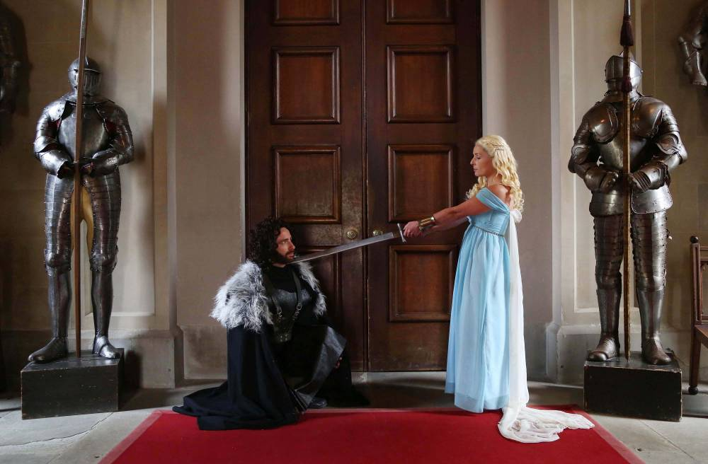 Game of Thrones superfans Kerry Ford and Darren Prew, who are dressed as Daenerys Targaryen and Jon Snow respectively, marry during their themed wedding at Eastnor Castle in Herefordshire, which was arranged by blinkbox. PRESS ASSOCIATION Photo. Issue date: Tuesday July 1, 2014. The couple, who are fans of Game of Thrones, won a competition organised by blinkbox to celebrate the release of season 4 of the television series. The couple and their guests spent fifty hours being transformed into their favourite characters by a team of hair and make-up artists, before marrying in the grounds of the castle, which was chosen for its similarity to that of the fictitious Kingís Landing from the series. See PA story SHOWBIZ Thrones. Photo credit should read: Geoff Caddick/PA Wire