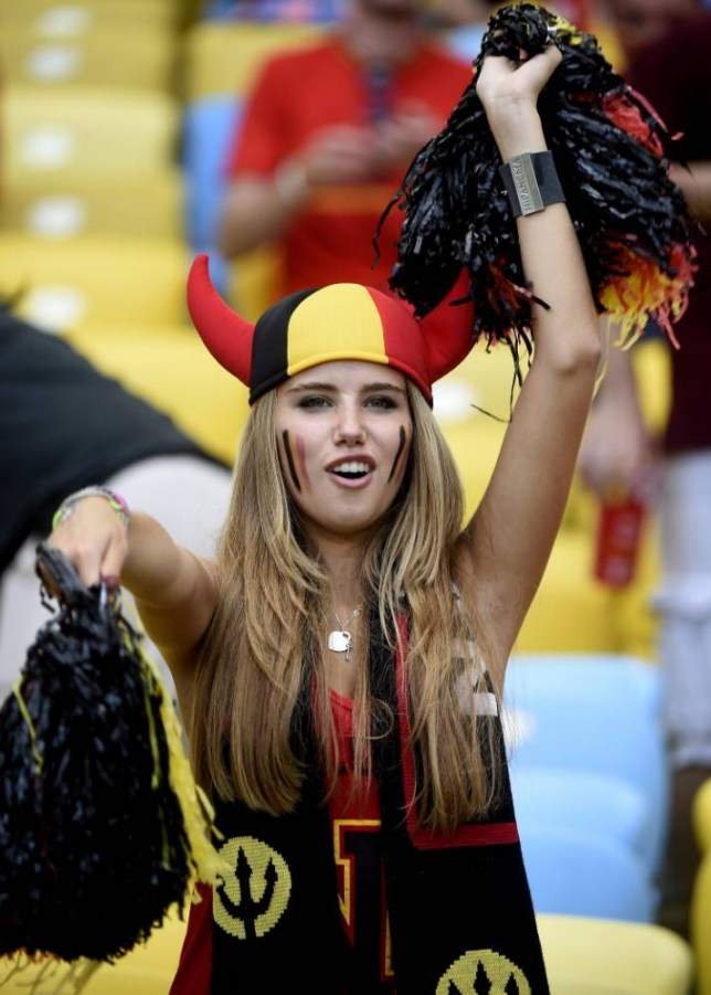 Axelle Despiegelaere, a Belgium fan poses as she waits for the start of the Group H football match between Belgium and Russia at the Maracana Stadium in Rio de Janeiro during the 2014 FIFA World Cup on June 22, 2014.  AFP PHOTO / MARTIN BUREAU        (Photo credit should read MARTIN BUREAU/AFP/Getty Images)