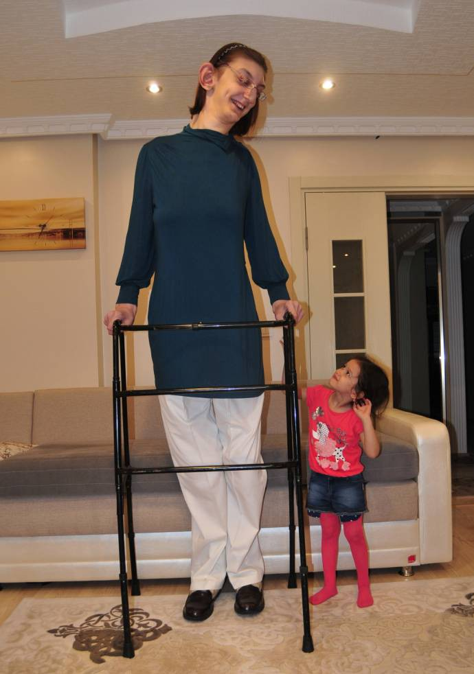 'I like being different, it makes me feel special': 7ft girl named world's tallest teenager