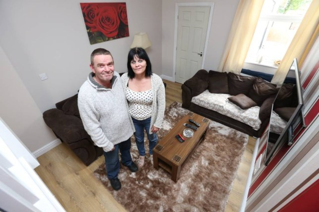 PIC BY MIKE JONES / CATERS NEWS - (PICTURED: Lawrence Poxton, 48,and his wife Teresa, 46 in their house) - Quids in! A couple have moved into Britains cheapest home - which set them back just a POUND - but could now fetch up to £70,000. Lawrence Poxton, 48, and his wife Teresa, 46, have moved into the terraced property in Stoke-on-Trent, Staffs, after the council put 33 properties on the market for a quid in a desperate attempt to clean up the area. The bus driver and his wife were picked from thousands of applicants to be the first couple to move into the houses - which they now estimate could be sold for between £60 - 70,000. The couple first applied to get the keys to one of only 33 houses available for £1 in Stoke-on-Trent, Staffs, in March 2013. After being selected from thousands of applicants, the lucky couple blindly picked their new terraced treasure out of a model house in November. SEE CATERS COPY.