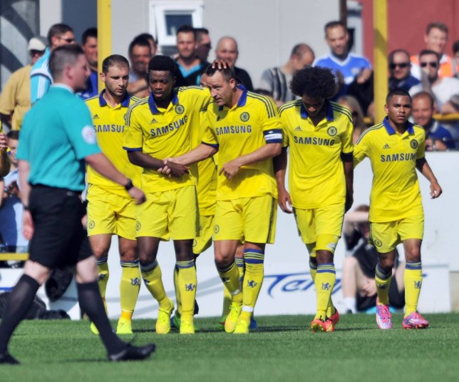 Chelsea XI's John Terry celebrates scoring with team-mates during the Pre-Season friendly at the The Cherry Red Records Stadium, Surrey. PRESS ASSOCIATION Photo. Picture date: Saturday July 19, 2014. See PA Story SOCCER Chelsea. Photo credit should read: Tim Parker/PA Wire.
