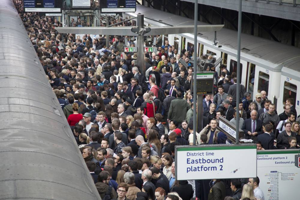 Commuters try to get on a train on the District Line of the London Underground during the 48-hour tube strike at London's Earl's Court tube station in England on April 29, 2014.   LONDON, ENGLAND - APRIL 29 :   (Photo by Yunus Kaymaz/Anadolu Agency/Getty Images)