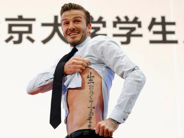 "Former England captain David Beckham shows his tattoo after he was asked to by students at Peking University during his visit in Beijing March 24, 2013. The tattoo in Chinese characters reads, ""Life and death are determined by fate, rank and riches decreed by Heaven.""   REUTERS/Stringer (CHINA - Tags: SPORT SOCCER ENTERTAINMENT TPX IMAGES OF THE DAY SOCIETY) CHINA OUT. NO COMMERCIAL OR EDITORIAL SALES IN CHINA"