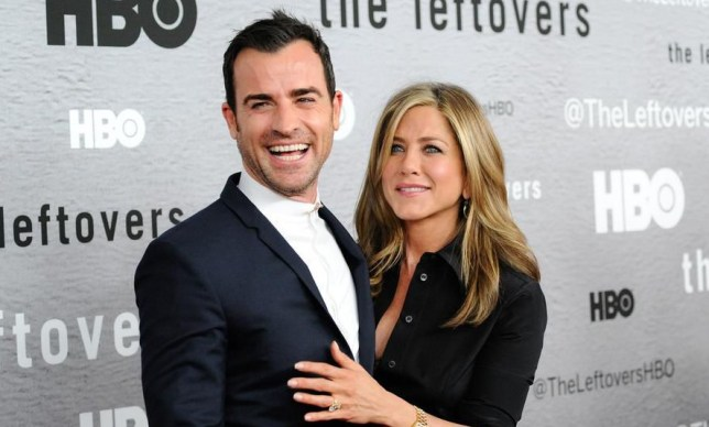 "Actors Jennifer Aniston, right, and Justin Theroux attend HBO's ""The Leftovers"" season premiere at the NYU Skirball Center on Monday, June 23, 2014 in New York. (Photo by Evan Agostini/Invision/AP)"