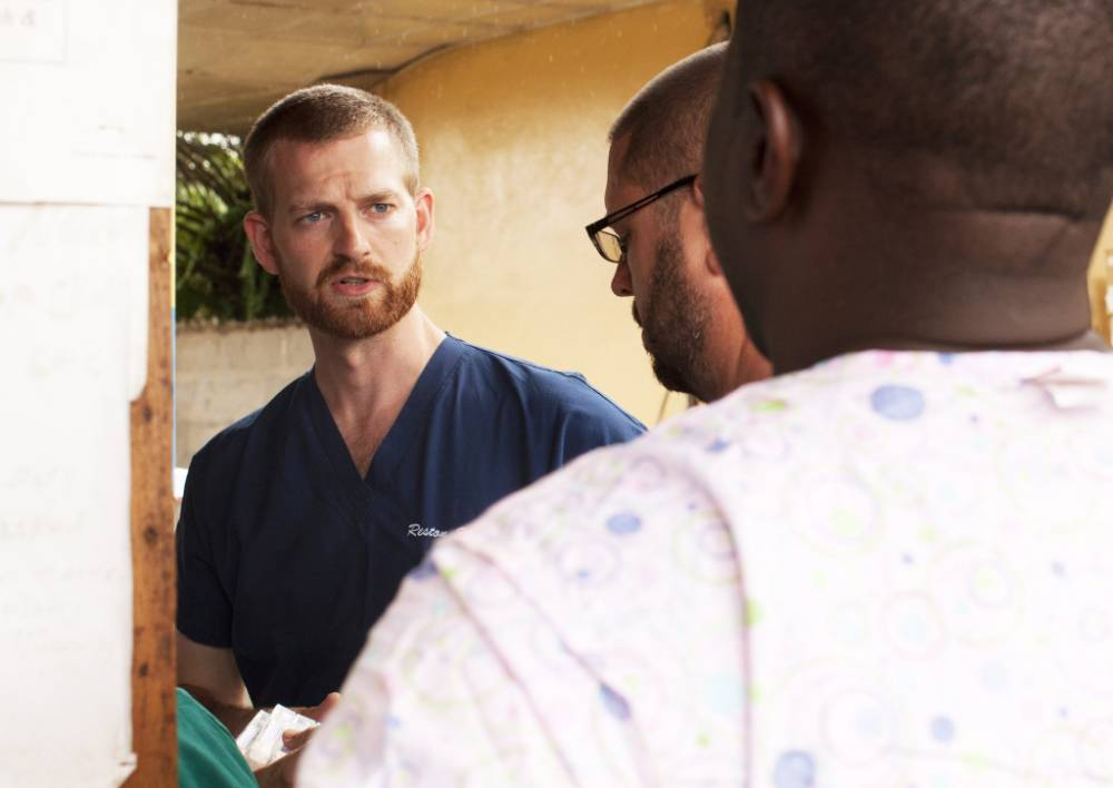 Brave doctor who risked his own life treating Ebola sufferers flown home on germ filter plane