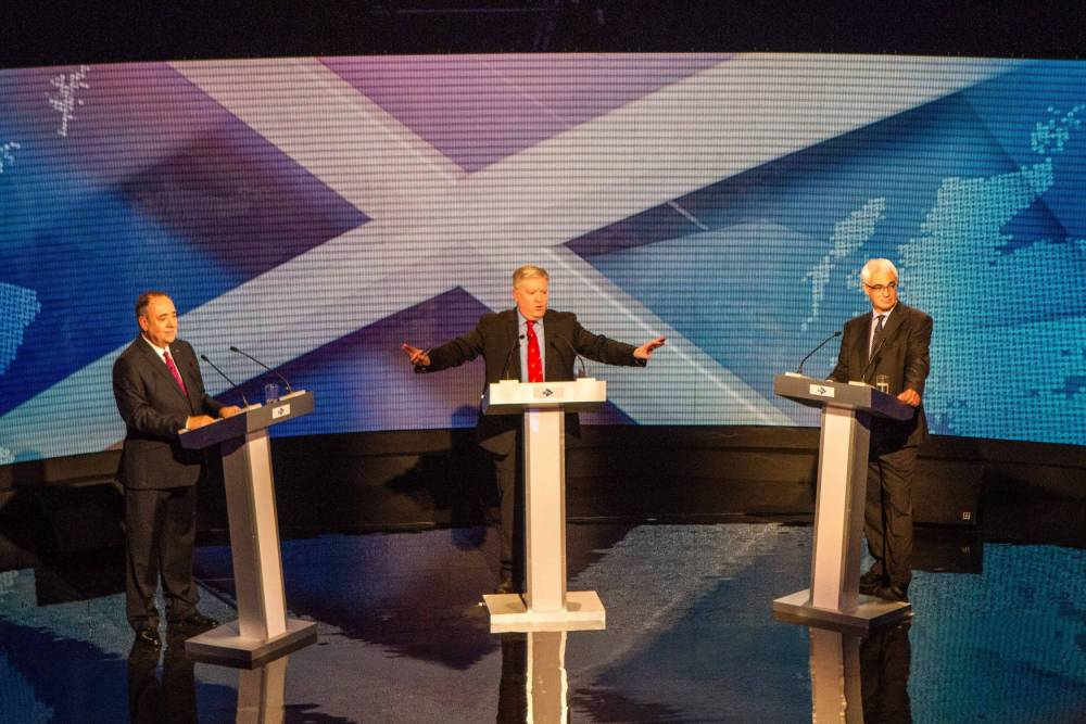 FREE FIRST USE ONLY EDITORIAL USE ONLY Handout photo issued by Devlin Photo Ltd of (left to right) Scotland's First Minister Alex Salmond, broadcast journalist Bernard Ponsonby, and former chancellor, the leader of the pro-UK Better Together campaign Alistair Darling at a TV debate of the independence referendum campaign in Glasgow. PRESS ASSOCIATION Photo. Issue date: Tuesday August 5, 2014. Broadcaster STV is staging tonight's TV showdown between the two rival politicians, with a second debate to take place on the BBC on August 25. See PA story REFERENDUM Debate. Photo credit should read: Devlin Photo Ltd/PA Wire NOTE TO EDITORS: This handout photo may only be used in for editorial reporting purposes for the contemporaneous illustration of events, things or the people in the image or facts mentioned in the caption. Reuse of the picture may require further permission from the copyright holder.