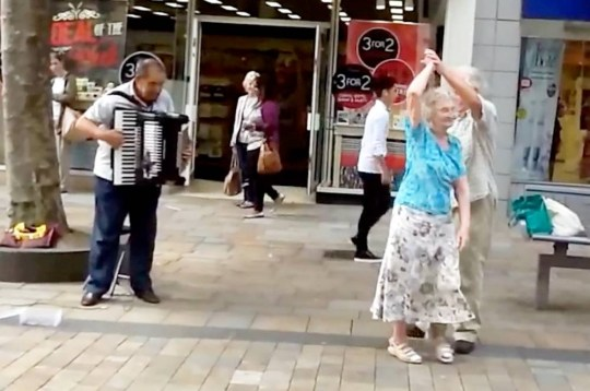 A dancing couple have become an internet hit after waltzing their way round a city centre to the simple accompaniment of an accordion.  See NTI story NTIDANCE.  Joan Culberwell, 86 and partner of 40 years, Thomas McGonigal, 84, brought Strictly to the streets when they broke out into an impromptu ballroom dance. The pair, who met at a dancing class, delighted dozens of passers-by with their ballroom routine to the sounds of a nearby busker at lunchtime on Monday (4/8).  Scores of shoppers and workers stopped in Wolverhampton city centre to watch the quick-footed couple and soon began to cheer and clap at the heart-warming scene.  Thomas, a former brick layer, said: ìWe have both started dancing when we were about 14. We love it.
