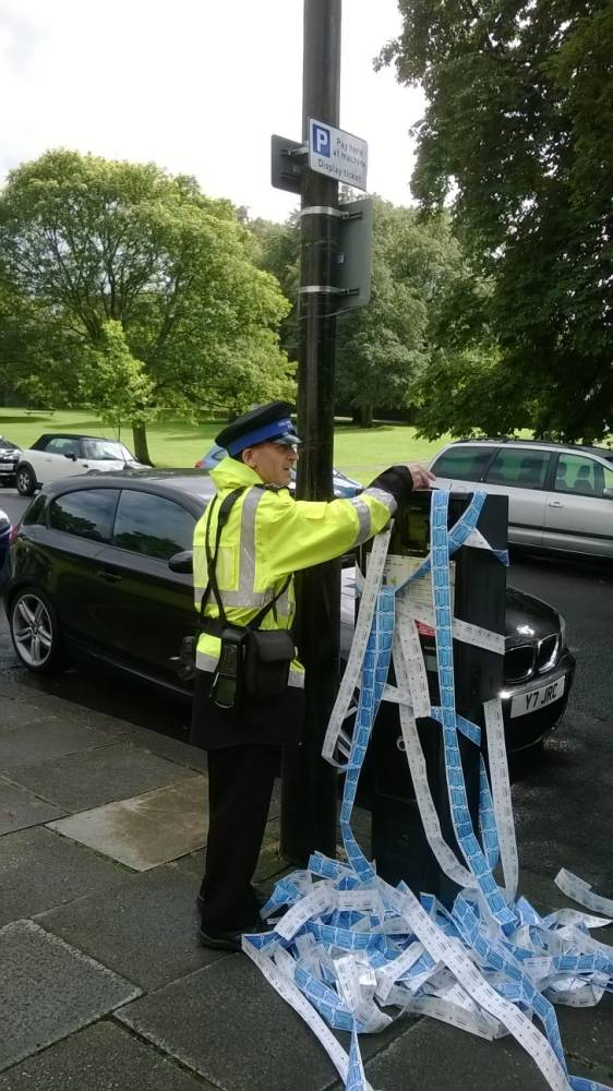 "Picture shows a parking ticket dispensing machine in Harrogate that printed out hundrets of tickets. See Ross Parry copy RPYTICKET : A parking attendant was having a bad ticket day when this out-of-control machine started spitting hundreds of tickets at him. The mischievous machine started spouting the tickets at the stressed attendant for over fifteen minutes before he finally manage to cut the power.  John Graham, 71, had been camping with his wife in Harrogate, North Yorks., when they spotted the amusing antics. The father-of-one said: ""I had been camping locally with my wife and we decided to go in to the centre for the day. As we walked around the corner near Betty's Tea Room we saw the machine.  ""The machine was printing continuously and these tickets just kept on coming. I would say that it was coming out at a ticket a second."