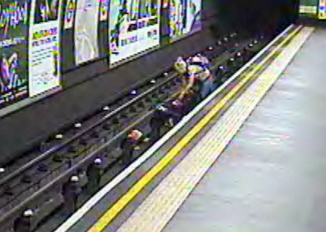 This is the dramatic moment a pushchair containing a small child was BLOWN on to tube tracks after its parents left it. See SWNS story SWPRAM: The buggy was left unattended by a man who walked up the stairs to help other family members. But the wind caught hold of the pram and pushed it on to the tracks of the Northern Line - just moments after a train had left the station. CCTV shows the child's mum throwing caution to the wind and jumping from the platform onto the tracks to get the pushchair and tot back to safety seconds before a train pulled in.