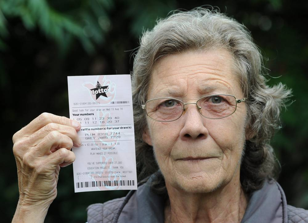 NO BROADCAST/ONLINE USE BEFORE 1PM. Elizabeth Wilson with her lottery ticket. See CENTRE PRESS story LOTTERY; A Scots grandmother blasted National Lottery bosses yesterday (Fri) after she won just £15 for four matching numbers, it was revealed yesterday (Fri). Elizabeth Wilson, 74, who has used the same numbers since 1994, beat 1,000-to-one odds to match four numbers in Wednesday night's draw. But she was stunned when the newsagent gave her less money than if she had guessed just three numbers. The grandmother-of-one from Prestonpans was one of 16,000 people who scored four numbers, which reduced the prize pot to just £15 per player