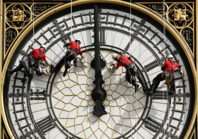 A specialist technical abseil team clean and inspect one of the four faces of the Great Clock, otherwise known as Big Ben, at the Houses of Parliament, in central London, as they undertake essential maintenance and cleaning of the four faces. PRESS ASSOCIATION Photo. Picture date: Monday August 18, 2014. Photo credit should read: Yui Mok/PA Wire