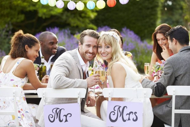 Mandatory Credit: Photo by Monkey Business Images/REX (3957306a).. MODEL RELEASED Bride And Groom Enjoying Meal At Wedding Reception.. VARIOUS.. ..