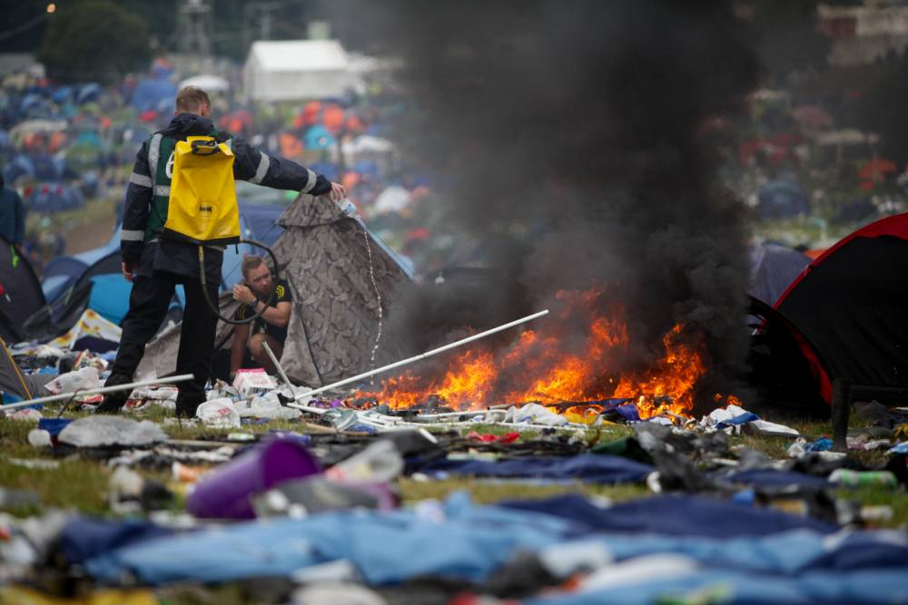 People leaving the Leeds Festival site have been setting fire to their tents