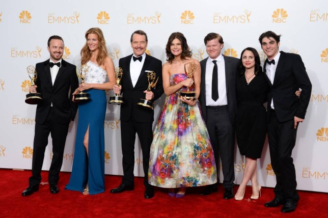 """Aaron Paul, from left, Anna Gunn, Bryan Cranston, Betsy Brandt, Jesse Plemons, Laura Fraser and RJ Mitte pose in the press room with the award for outstanding drama series for """"Breaking Bad"""" at the 66th Annual Primetime Emmy Awards at the Nokia Theatre L.A. Live on Monday, Aug. 25, 2014, in Los Angeles. (Photo by Jordan Strauss/Invision/AP)"""