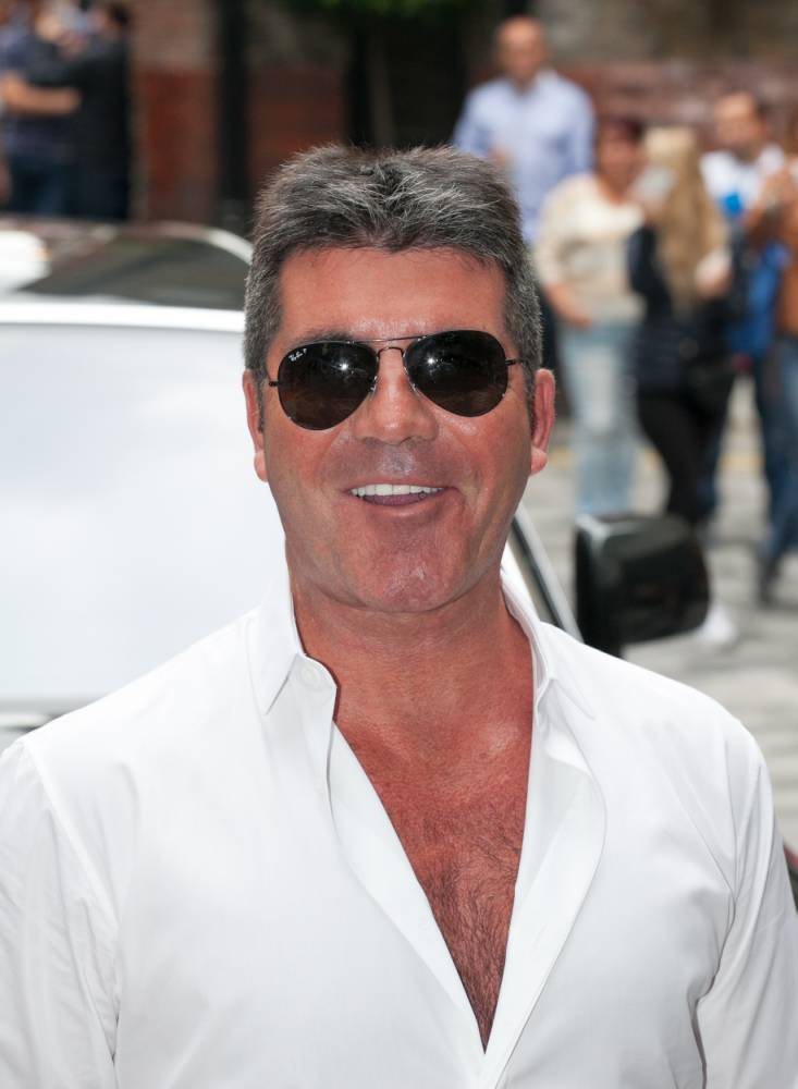 Simon Cowell arrives at the X-Factor press launch at the Ham Yard Hotel, Soho, London.  PRESS ASSOCIATION Photo. Picture date: Wednesday August 27, 2014. See PA story SHOWBIZ X Factor. Photo credit should read: Daniel Leal-Olivas/PA Wire