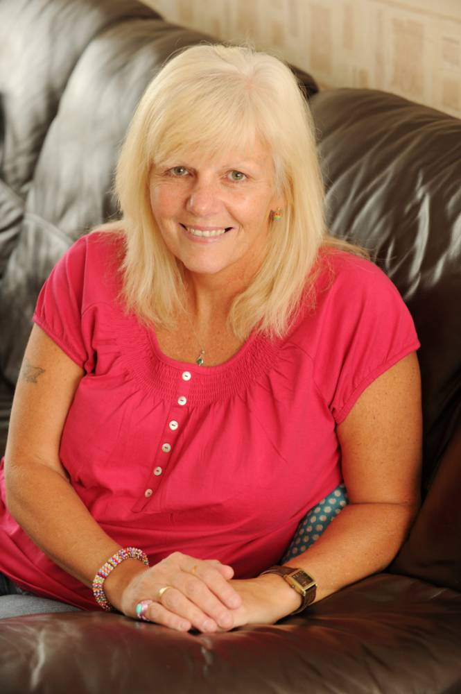 Tracey Stear whose 'tonsilitis' turned out to be 35 throat tumors. See SWNS story SWTHROAT; A mother-of-three was convinced she was suffering tonsillitis only to find her throat was riddled with 35 cancerous tumours - two the size of goose EGGS. Gutted Tracey Stear, 52, had large lumps in her mouth but had no idea they were dangerous until she went into hospital for an unrelated procedure. A doctor took one look at the growths and ordered a biopsy before confirming the devastating news that Tracey had throat cancer. Tracey was cut open from her right ear to her collar bone to remove the lumps, meaning she had to be fed through her stomach for four months and lost more than two stone.