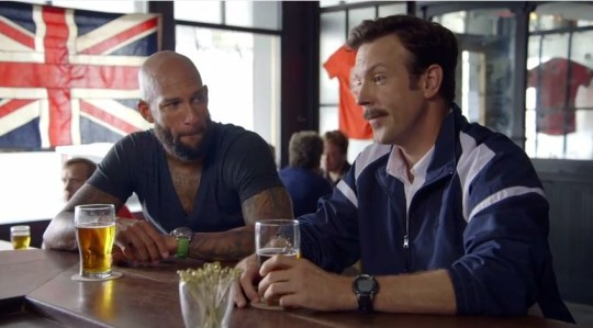 Jason Sudeikis returns as hapless coach 'Ted Lasso' and tries to talk football with Tim Howard (Picture: NBCSportsNetwork)